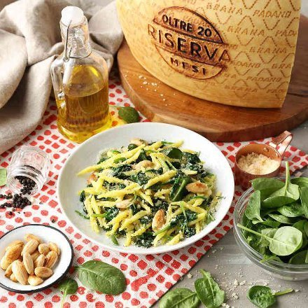 trofie pasta with spinach, almonds and Grana Padano PDO