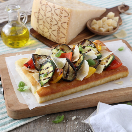 Focaccia bread with grilled vegetables, basil and Grana Padano shaves